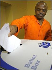 Prisoner at Pretoria's Maximum Security prison, CMAX, places his vote in the ballot box (pic: Jason Boswell)