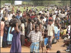 Sri Lankan ethnic Tamil civilians evacuated from the war zone wait at a transit camp for registration in Omantai, about 230 kilometers (144 miles) north of Colombo, Sri Lanka, Tuesday, April 21, 2009