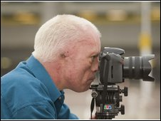 Photo of John Roberts using his camera