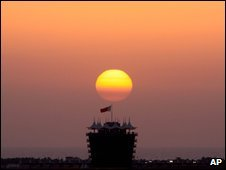 The sun sets at the Bahrain International Circuit in Sakhir, Bahrain, on 21 April