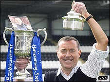 Billy Abercromby holds the Scottish Cup