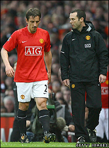 Neville leaves the pitch