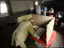A voter casting his ballot in Bihar, India on 23 April
