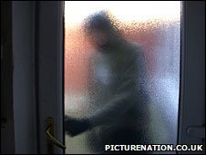 A burglar breaking into a house