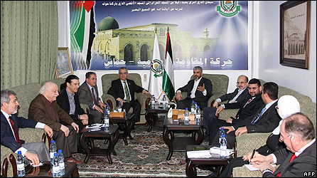 Hamas's political leader Khaled Meshaal greets Greek and Italian parliamentarians