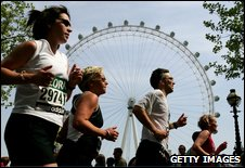 Runners pass the London eye