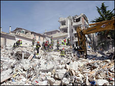 Rescuers search the rubble in L'Aquila, 7 April 2009