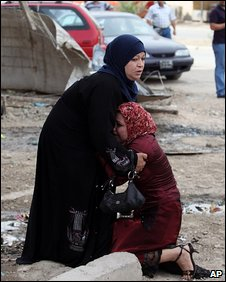 Two women react to the suicide bombing in Baghdad, 23 April 2009
