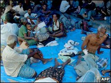 Ethnic Tamiles believed to be victims of fighting in northern Sri Lanka wait at a hospital in Vavuniya