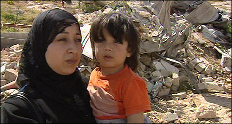 Ihdaidoons outside thier destroyed home in East Jerusalem