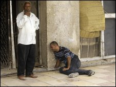 A relative of a victim of a suicide bombing in Baghdad on 24 April grieves near the scene of the blast