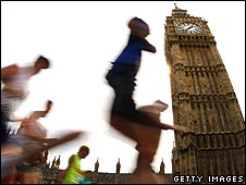 Runners pass the Palace of Westminster