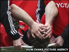Munster scrum-half Tomos O'Leary is carried off with a worrying injury