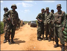 Soldiers block the road at Puthumatalan, close to the frontline