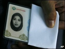 Akiko Saberi, mother of the American-Iranian journalist Roxana Saberi, shows her daughter's Iranian identity card