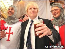 "London Mayor Boris Johnson stands with two knights at Leadenhall Market for St George""s Day on April 23"