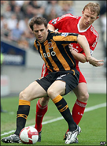 Kevin Kilbane battles for the ball with Liverpool's Dirk Kuyt