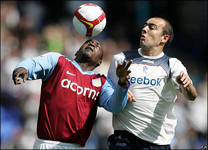 Aston Villa's Emile Heskey heads the ball under pressure from Gavin McCann