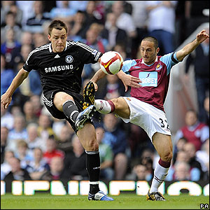 Chelsea skipper John Terry clashes with West Ham's David Di Michele
