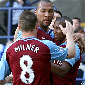 Ashley Young is congratulated by his Aston Villa team-mates after scoring the equaliser