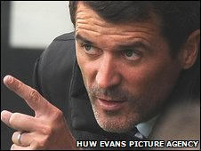 Roy Keane watches from the dugout as Ipswich win at Cardiff
