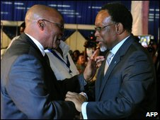 ANC leader Jacob Zuma (left) is congratulated by South African President Kgalema Motlanthe in Pretoria, 25 April