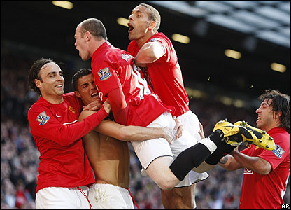 United's players celebrate Ronaldo's second