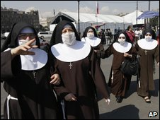 A group of nuns walk wearing surgical masks in Mexico City