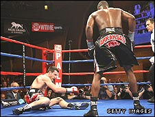 Carl Froch (left) is floored by Jermain Taylor