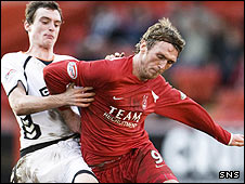 David Robertson and Lee Miller tussle for possession