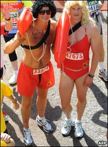 Two runners dressed as Baywatch lifeguards