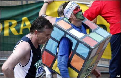 A runner dressed as a Rubik's Cube