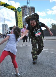 Young supporter with runner