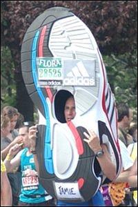 Man dressed as giant running shoe