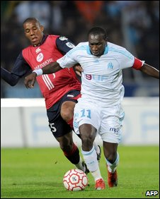 Emerson of Lille and Marseille forward Mamadou Niang
