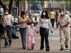 A family wearing surgical masks in Mexico City