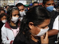 People wearing masks as they visit a Mexican hospital