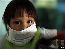 A Mexican boy wears a protective face mask