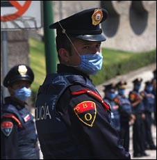 A masked policeman in Mexico City on 26 April 2009