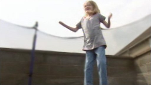 Lauren Rogers jumping on a trampoline