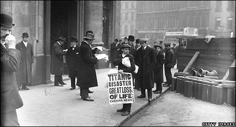 Newspaper boy Ned Parfett sells copies of the Evening News telling of the Titanic maritime disaster, outside the White Star Line offices at Oceanic House in London's Cockspur Street