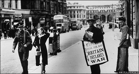 A man displays a billboard in the Strand as war is declared