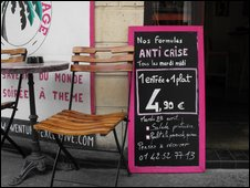 Board advertising 'crisis menu' at Paris restaurant