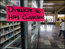 "A sign at a Mexico City pharmacy reads (in Spanish) ""Sorry, we're out of masks"""