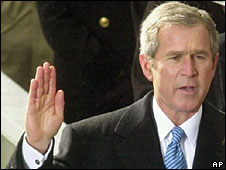 President George W Bush takes the office at his inauguration, 20 January 2001