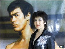 Betty Ting Pei in front of Bruce Lee poster, 2003