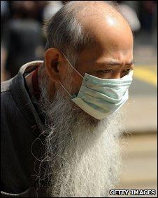 An elderly man wears a surgical mask in Hong Kong