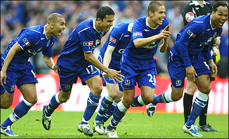Everton players celebrate the winning penalty that sealed victory over Manchester United in the semi-final