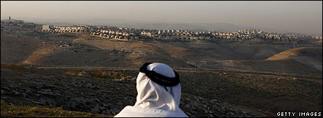 Arab man looks over Israeli settlement of Ma'ale Adumim