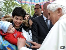 Pope Benedict XVI (R) greets earthquake survivors in Onna, Italy,  28 April 2009